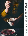 female hands pouring ripe... | Shutterstock . vector #1208235949
