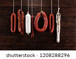 sausages hang from a rack at... | Shutterstock . vector #1208288296