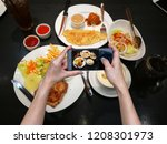 human hand holding a smartphone ... | Shutterstock . vector #1208301973