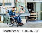 disabled worker in wheelchair... | Shutterstock . vector #1208307019