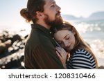 affectionate couple embracing... | Shutterstock . vector #1208310466