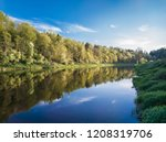 river bank in the rays of the... | Shutterstock . vector #1208319706