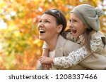 portrait of mother and daughter ... | Shutterstock . vector #1208337466