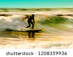 surfer in motion on wave | Shutterstock . vector #1208359936