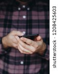 close up of man using... | Shutterstock . vector #1208425603
