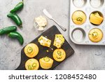 Stock photo flat lay home made cornbread muffins with spicy jalapeno pepper with spread of butter 1208452480