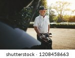 smiling senior man packing his... | Shutterstock . vector #1208458663
