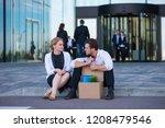 fired business man sitting...   Shutterstock . vector #1208479546