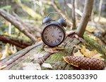 vintage black alarm clock on... | Shutterstock . vector #1208503390