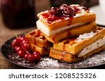 viennese waffles with powder... | Shutterstock . vector #1208525326
