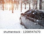 dark gray car stands in the... | Shutterstock . vector #1208547670
