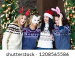 young women wearing funny masks ... | Shutterstock . vector #1208565586