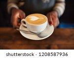 closeup of an african barista... | Shutterstock . vector #1208587936