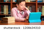 cute schoolboy using computer... | Shutterstock . vector #1208634310