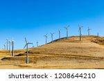 Wind Turbines On The Hills At...