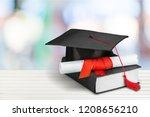 graduation mortarboard on  book ...   Shutterstock . vector #1208656210