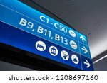 direction signs inside a large... | Shutterstock . vector #1208697160