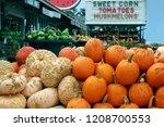 ripe pumpkins in a market | Shutterstock . vector #1208700553