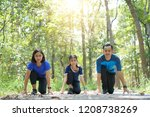 asian family exercising and... | Shutterstock . vector #1208738269