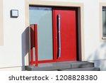 modern red front door | Shutterstock . vector #1208828380