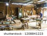 man doing woodwork in carpentry.... | Shutterstock . vector #1208841223