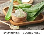 bowl with aloe vera on wooden... | Shutterstock . vector #1208897563