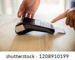 man hand pressing on credit... | Shutterstock . vector #1208910199