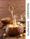 cheese fondue  bread bowl | Shutterstock . vector #1208920546