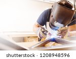 male in face mask welds with... | Shutterstock . vector #1208948596