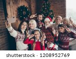 cheerful full family showing... | Shutterstock . vector #1208952769
