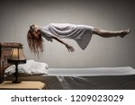 Woman Levitating Over Bed  ...