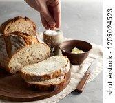 woman's hand sprinkling sugar... | Shutterstock . vector #1209024523