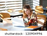young woman with laptop | Shutterstock . vector #120904996