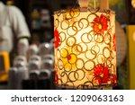a streetside shop selling... | Shutterstock . vector #1209063163