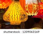 a streetside shop selling... | Shutterstock . vector #1209063169
