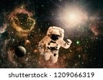 astronaut flies over the earth... | Shutterstock . vector #1209066319