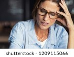 portrait of stressed mature... | Shutterstock . vector #1209115066