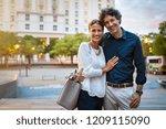 smiling mature couple in smart... | Shutterstock . vector #1209115090