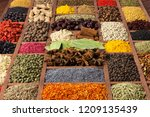 spices and herbs in wooden... | Shutterstock . vector #1209135439