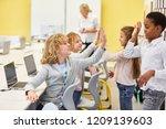 children in the elementary... | Shutterstock . vector #1209139603