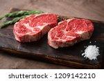 two fresh raw rib eye steak on... | Shutterstock . vector #1209142210