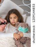 sick little girl | Shutterstock . vector #1209144853