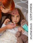 sick little girl | Shutterstock . vector #1209144856