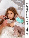 sick little girl | Shutterstock . vector #1209144859