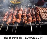 kebab roasted on the coals in... | Shutterstock . vector #1209211249