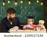 teacher and pupil in...   Shutterstock . vector #1209217150