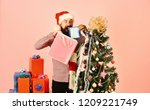 santa with colorful packets... | Shutterstock . vector #1209221749