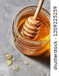 wooden stick in a glass jar... | Shutterstock . vector #1209225259