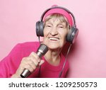 happy grandmother with... | Shutterstock . vector #1209250573