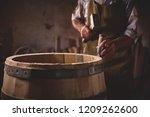 the master makes a wooden... | Shutterstock . vector #1209262600